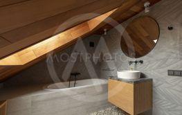 Interior of stylish attic bathroom