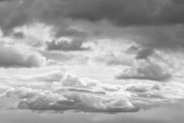 Atmosphere image with white and dark grey clouds