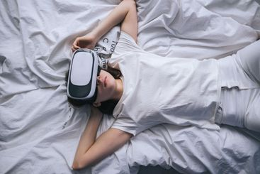 Woman use virtual reality glasses at home, relaxed on...