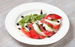 mozzarella cheese and tomato with basil leaves