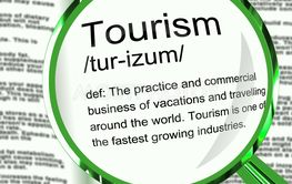Tourism definition meaning on holiday and having a break...