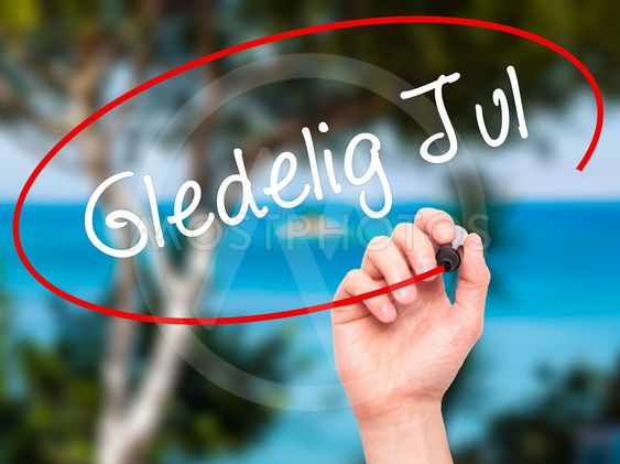 Man Hand writing Gledelig Jul  (Happy Christmas in...
