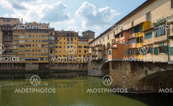 Ponte Vecchio landmark reflected on arno river....