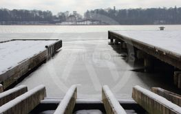 Perspective of Wooden Pier with Winter Snow