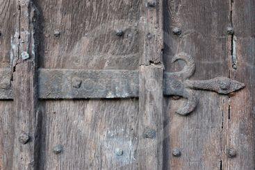 Ancient Wooden Door with Fleur-de-lis Ironwork