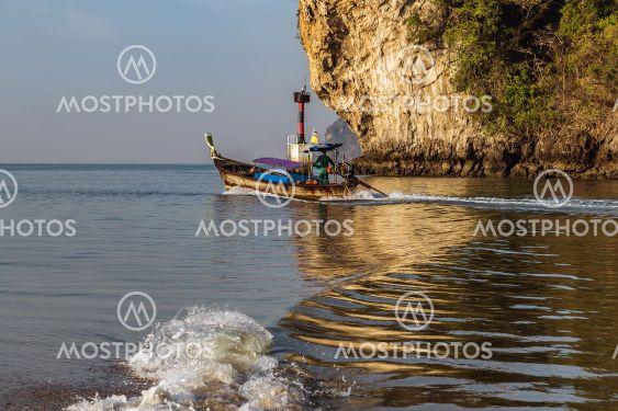 Thai traditional wooden longtail boat Limestone karst rocks