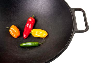 Four  Colorful Peppers in a Wok