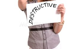 uncomfortable woman holding paper with Destructive text