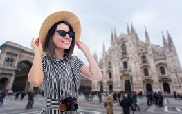 portrait of young beautiful woman tourist in straw hat...