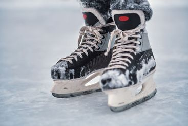 Close-up of the skates on the player feet after ice hockey