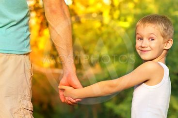 Happy Family Father Man and Son Boy Child holding hand in...