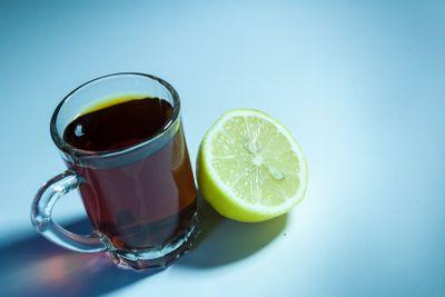 Slice of lemon and Glass of Black tea