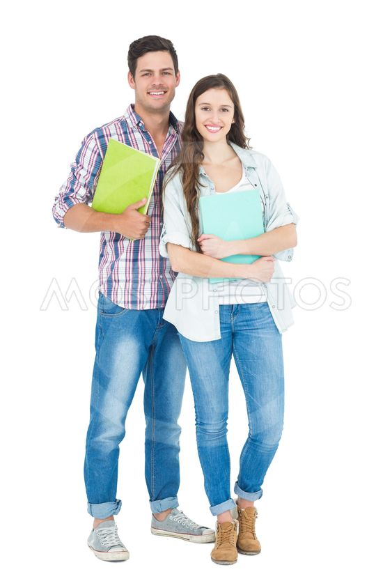 Portrait of students couple holding books