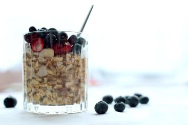 Oatmeal with chia, cranberry and blueberries on table