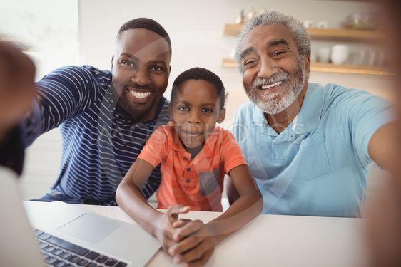 Happy multi-generation family looking at camera
