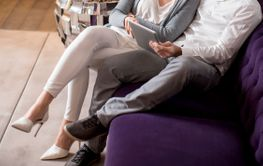 Young couple with digital tablet on sofa