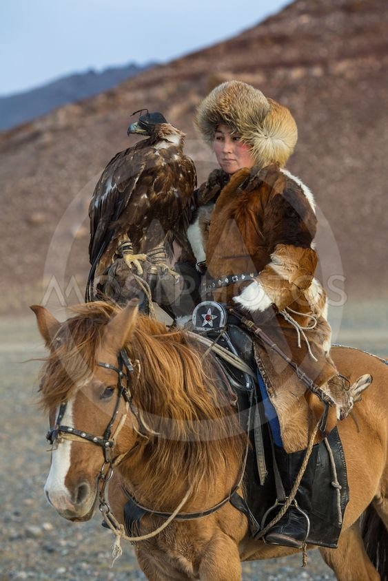 Golden Eagle Hunter teaches her young daughter hunting...
