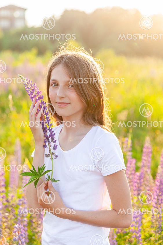 Happy teenage girl smiling outdoor. Beautiful young teen...