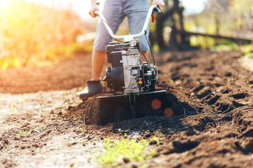 close up photo of young farmer gardener cultivate ground...