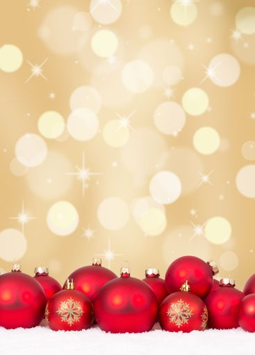 Christmas red balls decoration with golden background