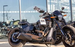 modern harley davidson for sale parked in front of the...