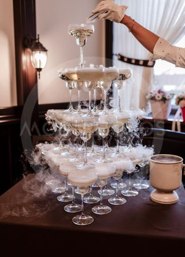Glasses with alcoholic. Pyramid of champagne glasses with...