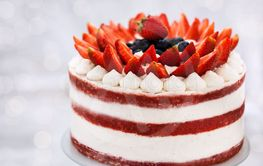 Delicious homemade naked red velvet cake decorated with...
