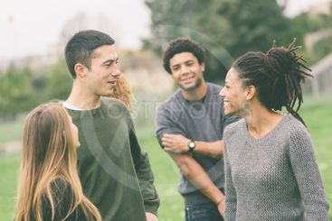 Multiethnic group of friends at park