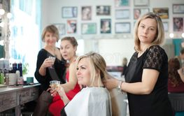 Two women friend in a beauty salon at the hairdresser...