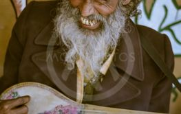 Man playing musical instrument in West Bengal