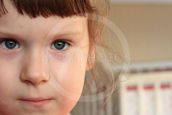 Little girl face close up with a blank space for text