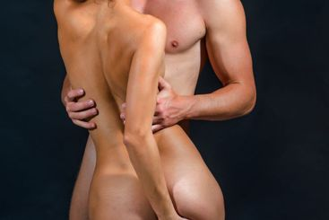 Naked couple in love with nude body, copy space