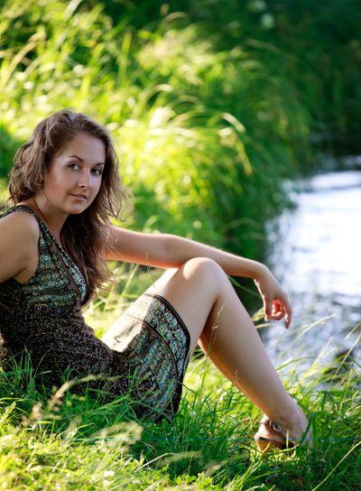 woman sitting on riverside