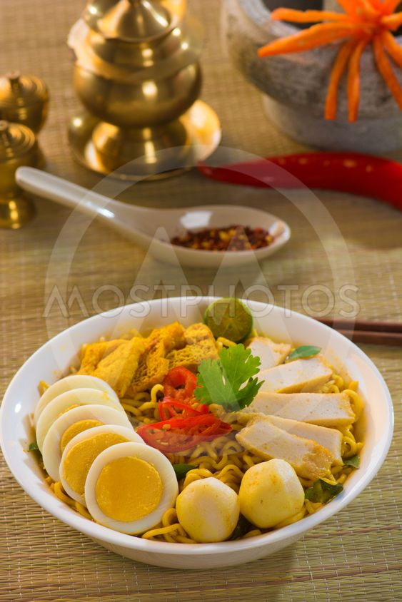 Hot and spicy Singapore Curry Noodle with decoration setup