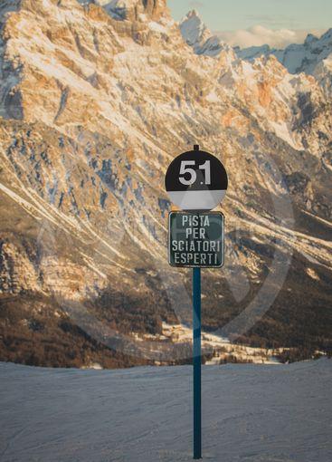 Black slope warning sign
