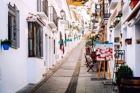 Charming whitewashed narrow street In Mijas