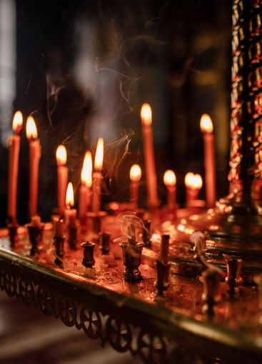 long lighted candles group in orthodox church. candles...