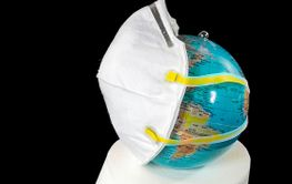 world globe with face mask