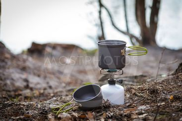 cooking on a gas burner stove in the woods