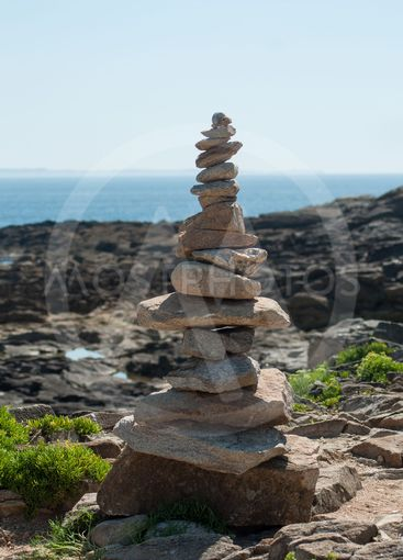 stone balance  in border ocean
