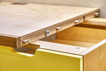 Plywood desk with multi color drawers during assembly....