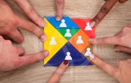 Group Of People's Hand On Colorful Tangram Puzzle Blocks