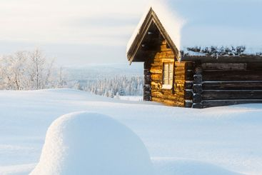 Wooden cabin in the mountains in winter