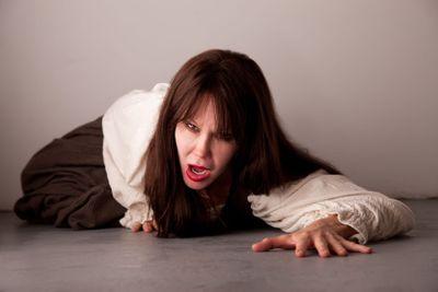 Female victim crawling on the floor