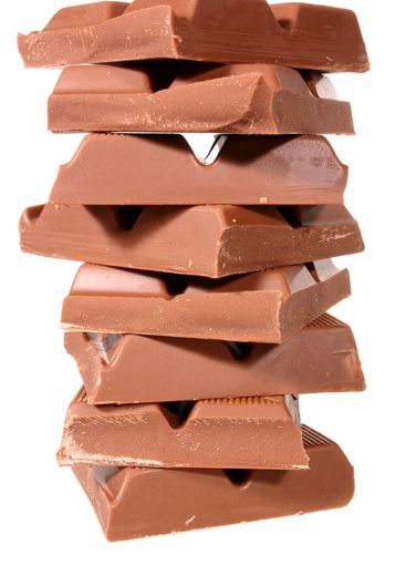 A pile of chocolate isolated on a white background.