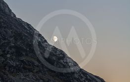 Moon rising over welsh mountainside