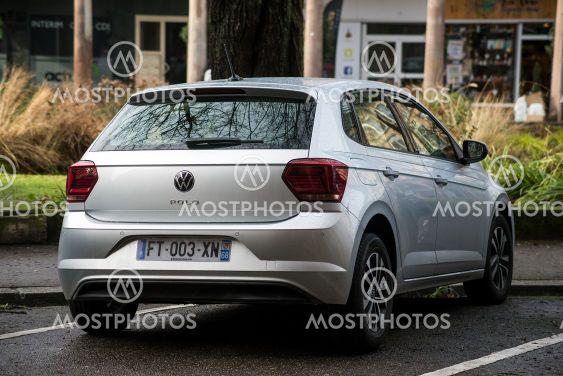 Rear view of grey Volkswagen Polo parked in the street