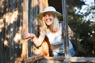Happy smiling emotional elderly woman having fun posing...