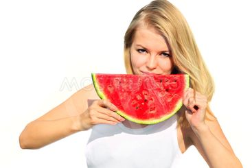 Young Woman eating big slice Watermelon Berry fresh in...