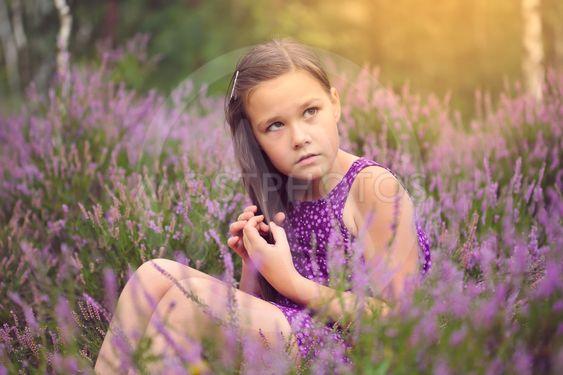 Girl in heather flowers